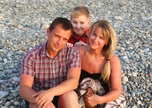 Viktar and family on beach