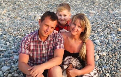 Viktar and family on beach